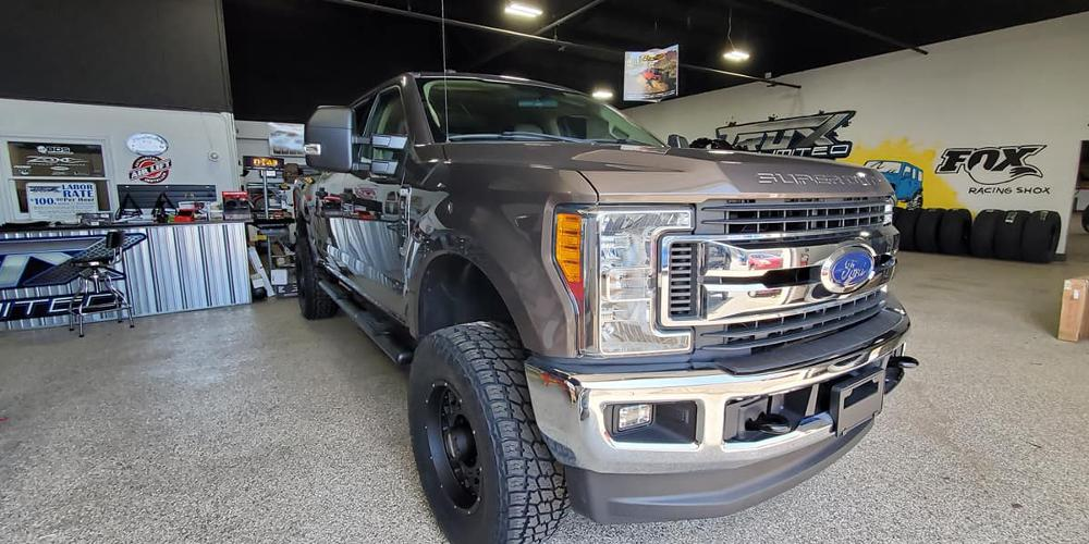 Ford F-250 Super Duty with Vision Off Road 412 Rocker